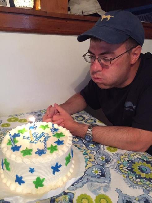 Me blowing out the candles of almond vanilla cake